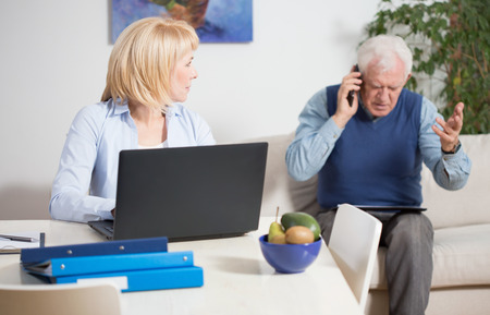 43941340 - elderly irate man talking phone with the client